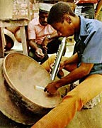 A Trinidadian panmaker tunes up a new pan